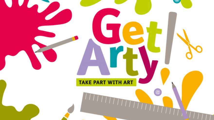 "Cartoon image with colourful paint splatters and text reading ""Get Arty!"""